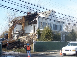 A work crew begins the demolition of the Forney House last Friday